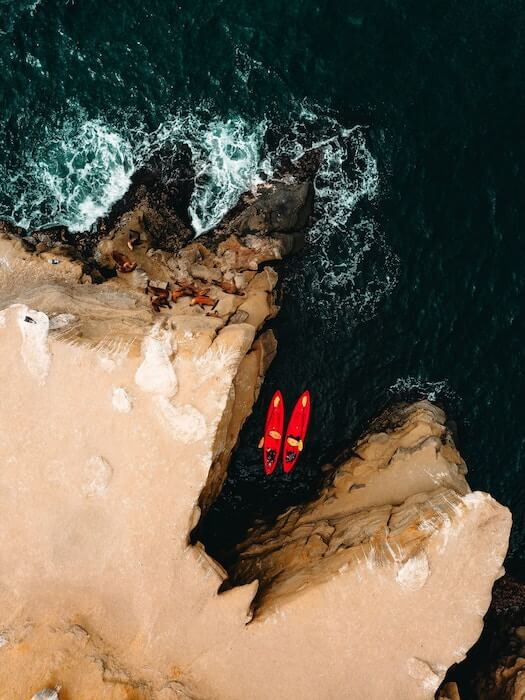 Two sea kayaks in a small alcove
